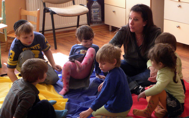 Amy Fingeret of Randolph spent Shabbat afternoon interacting with orphans at the Tikvah Infant Home for Jewish children in Odessa. Photos courtesy the Peoplehood Project