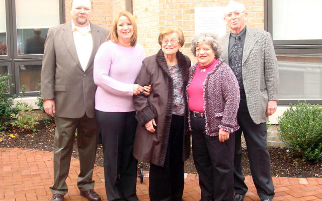 At the Nov. 26 dedication of the Aaron and Sarah Franzblau Patio at Daughters of Israel in West Orange are Sarah Franzblau, center, with two of her daughters and their husbands, Susan and Brian McMahon, left, and Arleen and Herbert Tarutz. Photos courte