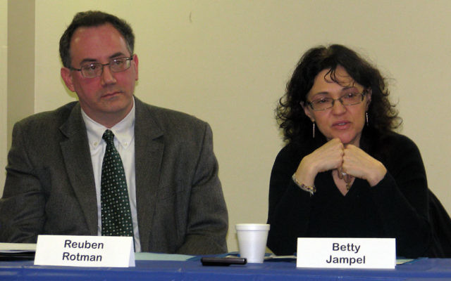 Reuben Rotman and Betty Jampel of the Jewish Family Service of MetroWest explain JFS programs to community rabbis.
