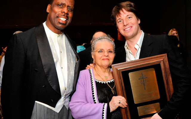 Joshua Bell, right, with Holocaust survivor Luna Kaufman, past endowment chair, and Metropolitan Opera bass Kevin Maynor.