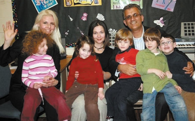 With children from the Russian language immersion class are, from left, parent Julia Benz, teacher Luiza Finberg, and head of school Moshe Vaknin.