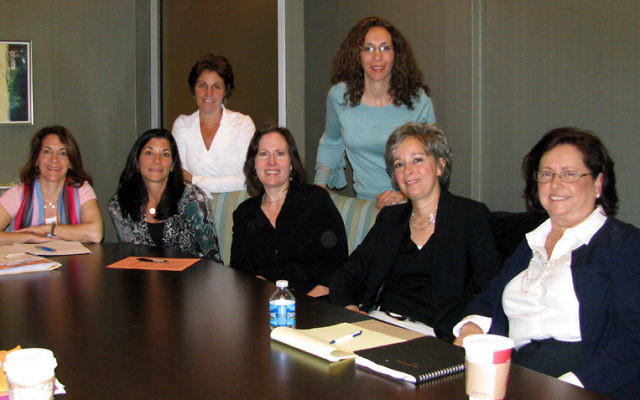At the April 27 meeting of synagogue leaders and JFS social workers are, from left, standing, Beth Sandweiss and Lisa Sturm, and, seated, Wendy Sabin, Beth Berns, Ilana Mazur, Ann Hicks, and Judie Gerstein. Photo by Robert Wiener