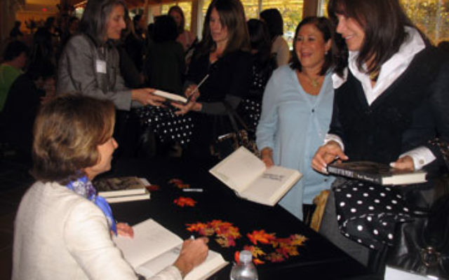 Kati Marton, left, signs books after the event.
