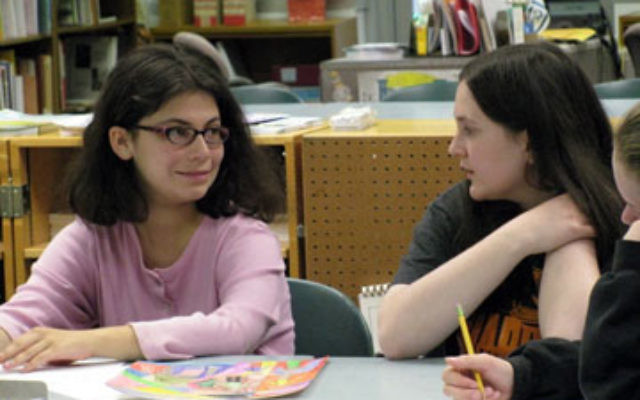Hannah Herbert, left, a student at the JTEENMW Learning Community, works with her shadow, Ellie Sandman.