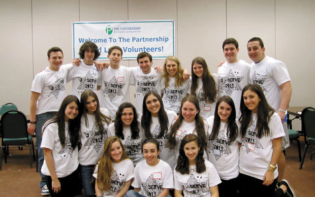 The J-Serve teen committee celebrates their day of service.