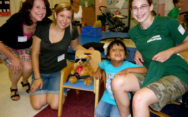 Members of the Steindler family, from left, Kelly and her daughters, Jessica and Romana, with Sandy at Cerebral Palsy of North Jersey's Horizon School on Aug. 9.