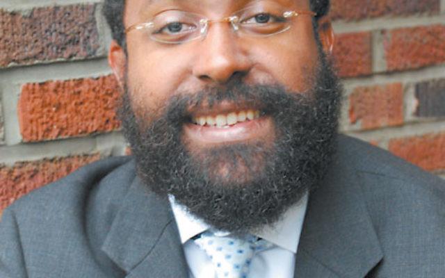 "Rabbi Enan Francis espouses Judaism ""without hyphens."""