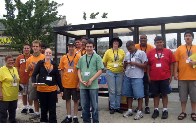 Navigating public transportation is a skill Career Campers practiced on their way to the Laurelwood Arboretum, when they took a NJ Transit Bus from Montclair to Willowbrook Mall. At the bus stop are, from left, JVS staff member Wanda Echevarria; campers