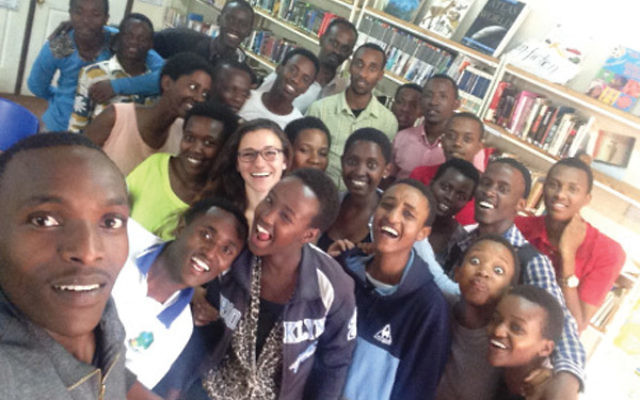 Naomi Stanway with members of the students she advised in a youth village in Rwanda.