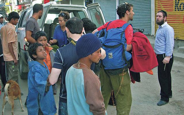 Rabbi Chezki Lifshitz, right, welcoming hikers to Kathmandu's Chabad House, March 2012
