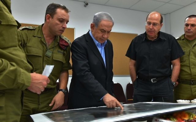 Israeli Prime Minister Benjamin Netanyahu and Defense Minister Moshe Yaalon being briefed in the South Front Command on Operation Protective Edge, July 9, 2014. (Ariel Hermoni/Ministry of Defense/Flash90)
