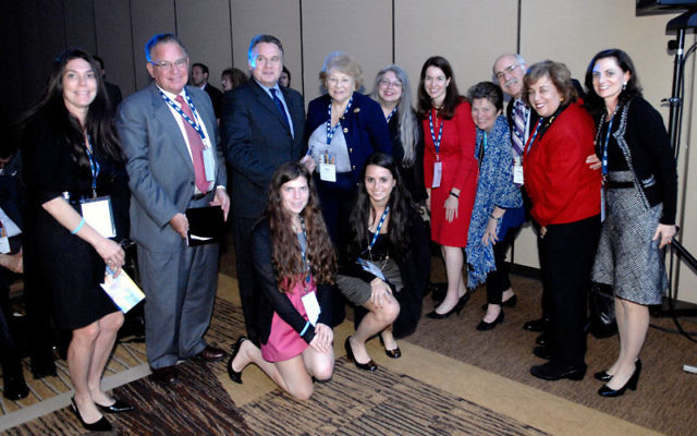 Rep. Chris Smith, third from left, with members of the NJ delegation to the American Jewish Committee Global Forum in Washington, DC, April 27, from left, standing, Ellen Lange, Herb Horowitz, Adele Agin, Janet Doerflinger, Kim Pimley, Allyson Gall, Louis