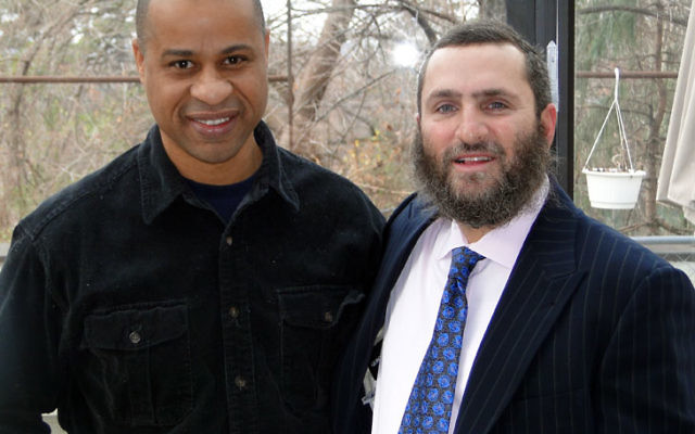 "John Taylor, left, Newark Mayor Cory Booker's half-brother, and Rabbi Shmuley Boteach have joined forces in an initiative to ""Turn Friday Night into Family Night."""