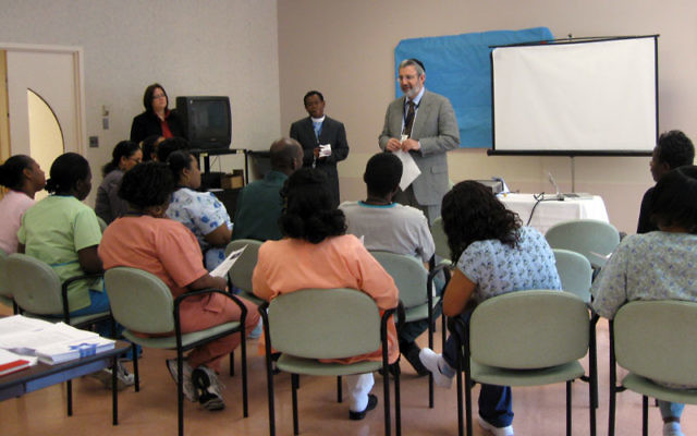 Rabbi Zvi Karpel, chaplain at Daughters of Israel in West Orange, leads a healing session April 14 at the facility for seniors with the Rev. Noster Montas and the Rev. Julie Taylor.