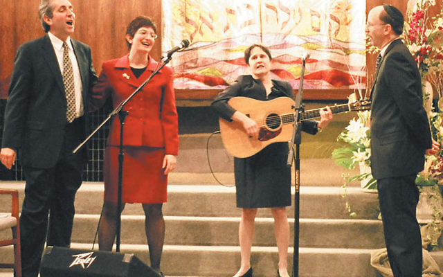 Debbie Friedman, who died over the weekend, singing and playing guitar at the 2005 installation ceremony for Rabbi Francine Roston at Congregation Beth El in South Orange.