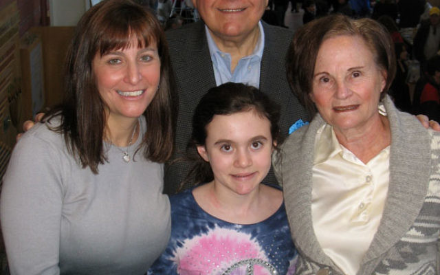 Leon and Toby Cooperman with daughter-in-law Jodi and granddaughter Courtney at Mitzvot of MetroWest, Jan. 25 on the Aidekman campus in Whippany. The Coopermans have established a family fund to support Jewish camping, Birthright Israel, and mitzva progra