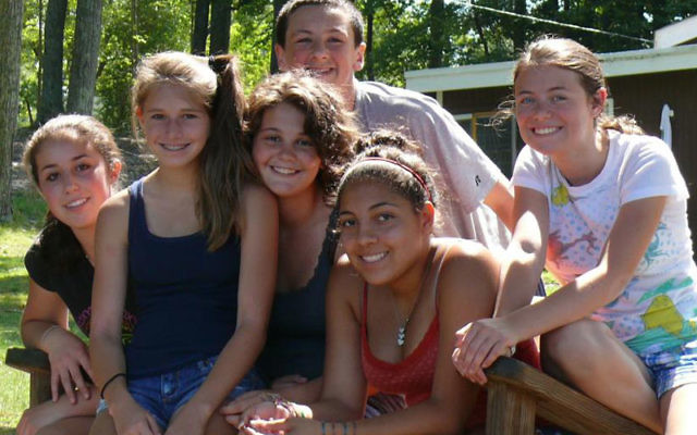 Rose Fellerman, third from left, whose father is a chief petty officer in the United States Navy, has been able to attend a Jewish summer camp through a scholarship provided by the NJ Y Camps to children with family members on active service in the U.S.