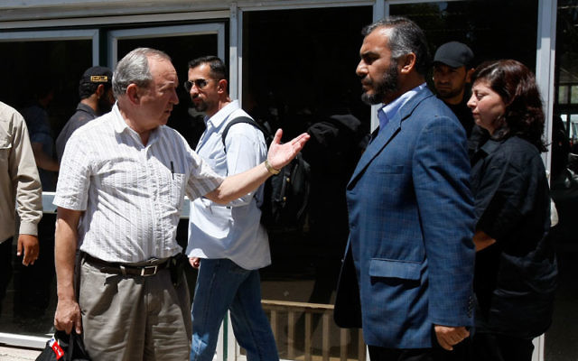 Richard Goldstone, left, shown meeting on June 1, 2009, with Ghazi Hamad of Hamas at the Rafah border crossing with Egypt, now says his report's finding that Israel intentionally targeted civilians in the Gaza war was mistaken. Photo by Rahim Khatib