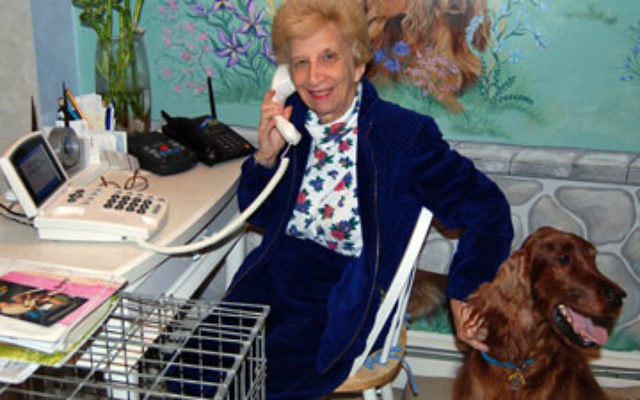 Beverly Sudler, accompanied by her beloved Irish Setter, says the CapTel captioned phone eases isolation for the hard-of-hearing.
