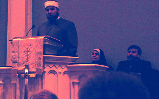 Imam Shazlei Shaban, introduced by Rabbi Mark Mallach, right, took part in the Nov. 22 interfaith service at First Presbyterian Church in Springfield. Photo by Elaine Durbach