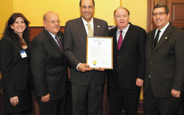 Israeli Consul General Ido Aharoni, center, displays his proclamation with, from left, Melanie Roth Gorelick, associate director, MetroWest Community Relations Committee; Roger Jacobs, vice president, NJ State Association of Jewish Federations; State Sen.
