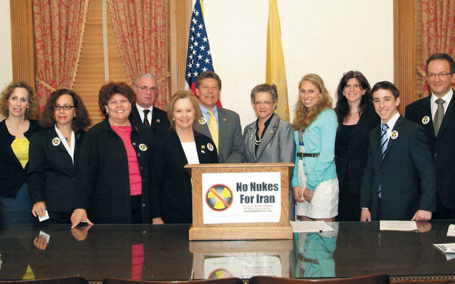 Jewish leaders gathered May 9 with legislators after the NJ State Assembly passed a resolution urging stiffer sanctions against companies doing business with Iran. At the Statehouse in Trenton are, from left, Nancy Kislin Flaum, No Nukes for Iran; Beth Ha