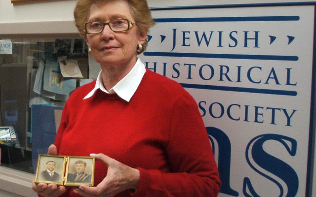 Ann Bernstein, holding photographs she donated to the Jewish Historical Society of MetroWest, uncovered a cache of letters written by a relative caught up in the Holocaust.