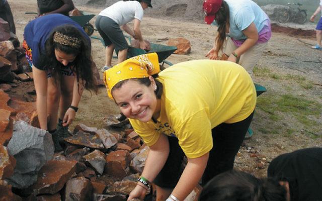 Elana Stern building a warehouse at the Agahozo Shalom Youth Village.