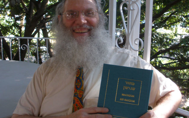 Rutgers professor Joseph Rosenstein with his Machzor Eit Ratzon, the High Holy Days prayer book he published in July. Photo by Debra Rubin