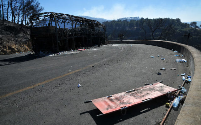 The remains of the burned bus in the Carmel Forest fire. Photo by Shay Levy/FLASH90