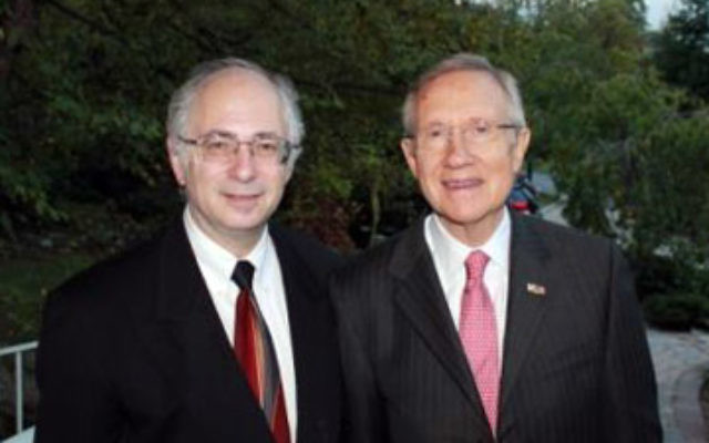United States Senate Majority Leader Harry Reid, right, at a Sept. 19 fund-raiser in Englewood hosted by NORPAC president Ben Chouake. Photo by Karen Pichkhadze
