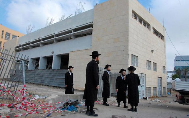 The site in Ashdod where, on Aug. 19, a Grad missile exploded within range of 900 yeshiva students and high school students beginning their school day — one of seven missiles fired from Hamas-controlled Gaza that hit Ashdod. Photo courtesy Noam Bede