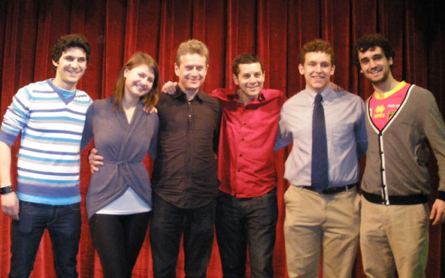 Student leaders join comedians Scott Blakeman and Dean Obeidallah, third and fourth from left, during the Stand Up for Peace program sponsored by Rutgers Shalom/Salaam. With them are, from left, Shalom/Salaam copresident Bahaa Hashem, board member Jane Vo