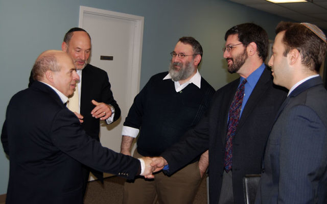 At a breakfast meeting hosted this week by the Central federation, Jewish Agency chair Natan Sharansky, with federation executive vice president Stanley Stone, second from left, greets, from left, Rabbi George Nudell, Rabbi Joel Abraham, and Rabbi Ben G