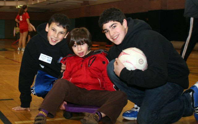 Enjoying activities at Gold's Gym on the Aidekman campus as part of Friendship Circle's Saturday night out are, from left, Alex Shedlin, Max Smokler, and Jeremy Bondy. Photos courtesy Friendship Circle of MetroWest NJ