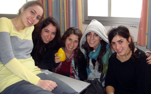 At Beit Sefer Tehila in Jerusalem are participants in Yeshiva University's A Place Called Home program, including Elizabeth residents Dina Wecker, center, and Orah Jooyandeh, second from right.