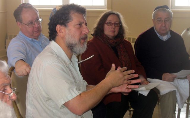 David Zinner, front, executive director of Kavod v'Nichum, offers a training session on tahara to about 25 people from Morristown Jewish Center-Beit Yisrael, including, from left, Ira Hammer, Barbara Kavadias, and Phil Frost. MJCBY is formi