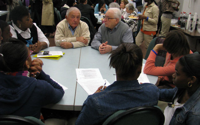 Survivors Carl Dubovy, left, and George Greene share their stories with students from Newark's Weequahic High School. Photos by Robert Wiener