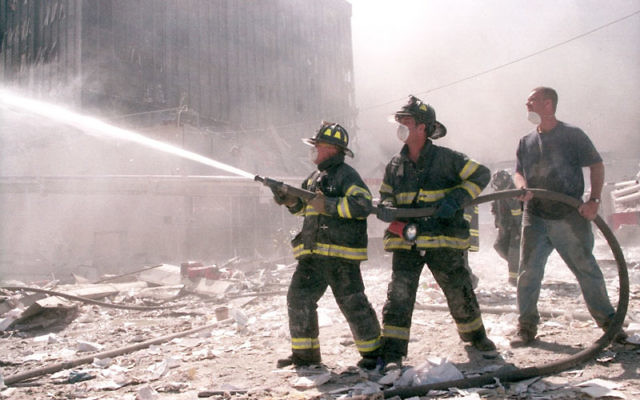 New York City firefighters work near Ground Zero after the collapse of the Twin Towers on Sept. 11. Photo by Anthony Correia/Shutterstock