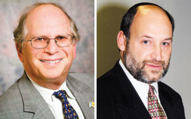 """Max Kleinman, left, executive vice president of UJC MetroWest NJ, said, """"We have to make sure that the different cultures of these two communities are respected."""" Central federation executive vice president Stanley Stone, right, said combining"""