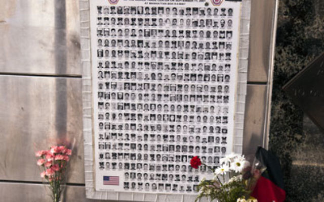 A poster remembers the firefighters who died on 9/11. Photo by Jorg Hackemann/Shutterstock
