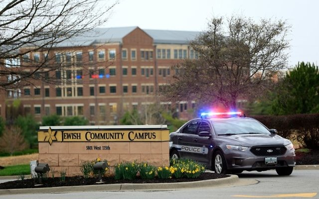 A police car is seen at the entrance of the Jewish Community Campus in Overland Park, Kan., after deadly shootings there and at a nearby assisted-living facility, April 13, 2014. (Jamie Squire/Getty Images)