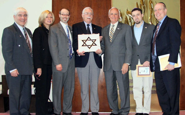 At the Salute to Friends of Israel at Congregation Brothers of Israel on March 27 are, from left, Lou Balcher, Consulate of Israel, Philadelphia; Sharon Schmidt, American Friends of Magen David Adom, Philadelphia; Rabbi Shalom Plotkin; Frank Ujfalusi, Sal
