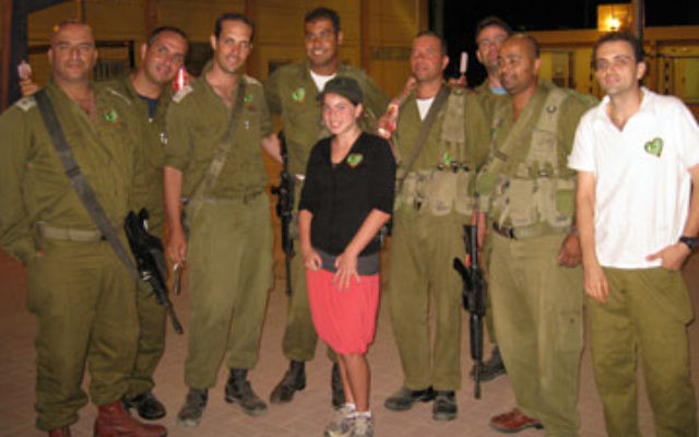 Peri Feldstein poses with Israeli soldiers at Gush Etzion after delivering treats and letters from her classmates in Princeton.