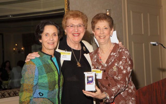 At last year's Women's Campaign Spring Luncheon, Carol Pollard, right, and Marsha Freeman, left, presented Rose Movitch with the Woman of Valor Award. Pollard will receive the 2010 Community Service Award at the annual meeting of the United
