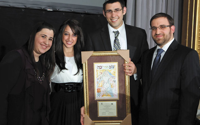 Aaron Horn and his wife, Daniella, center, with NJ NCSY Region director Rabbi Yaakov Glasser and Ben Zakkai Honor Society secretary Allison Katz at the society's 15th Annual Scholarship Reception on Jan. 30.