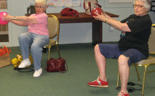 Seniors take part in a strength-training session, part of an exercise program for Secure@Home members held at The Jewish Center in Princeton.
