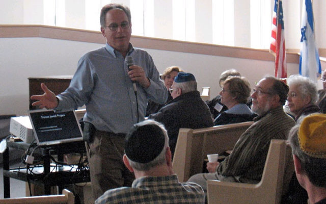 Ed Alpern tells the more than 60 people gathered March 13 at Adath Israel Congregation about the Trenton Jewish Project.