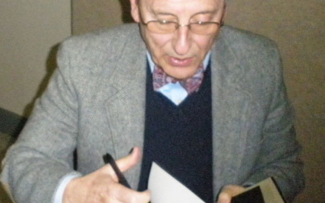 Following his appearance at Rutgers University, Samuel Heilman signs a copy of his book on the life of the seventh Lubavitcher rebbe. Photo by Debra Rubin