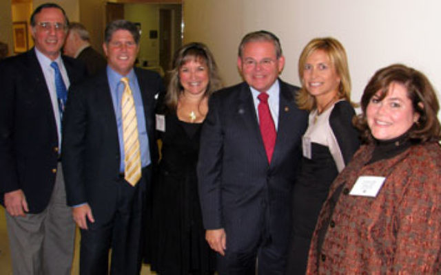With Sen. Robert Menendez, fourth from left, are United Jewish Federation of Princeton Mercer Bucks vice president Lionel Kaplan, campaign vice president Mark Merkovitz, Women's Campaign president Stacey Wasserman, federation president Lisa Smukler,